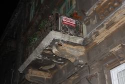 the sign alerts you to beware of the crumbling balcony - typical Budapest