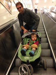 121 - And here's me and daddy on the metro escalators - i look sleepy here but I actually loved it.jpg