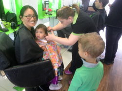 142 - my first big boy haircut as Peti looks on (can you spot daddy also getting his hair cut?).jpg