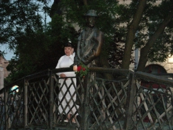 """Jeremy sez: """"Random woman on cell phone with statue on bridge in Budapest"""""""
