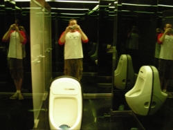 Jeremy visibly impressed by the amazing mirrored urinal at TG restaurant