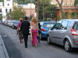 a group of shockingly well-dressed folks out for a stroll